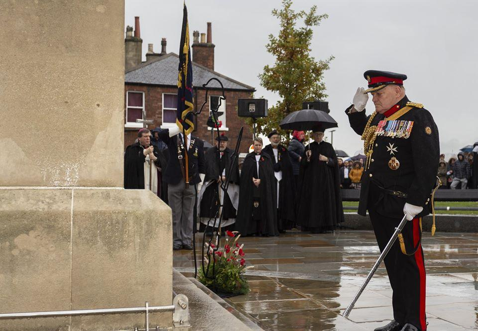 Service personnel laying their wreaths