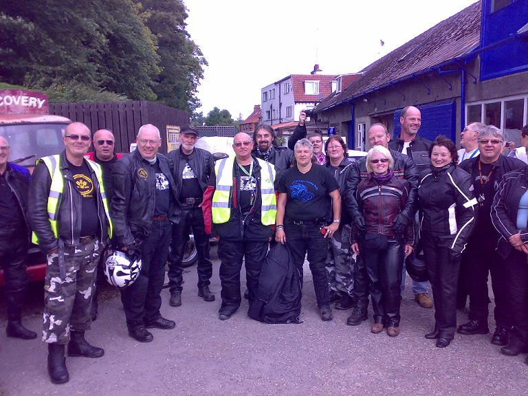 Group Photo at Scripps Garage in Aidensfield